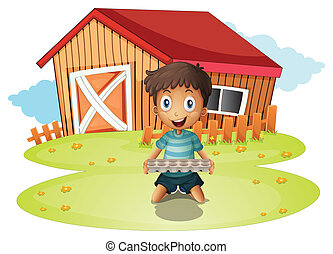 A boy holding an egg tray