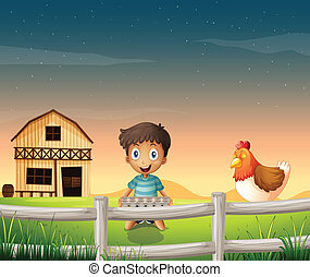 A boy holding an egg tray near the sleeping chicken