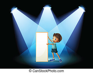 A boy holding an empty board with spotlights