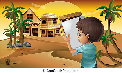 A boy holding an empty paper at the desert