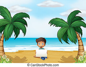 A boy holding an empty signage at the beach