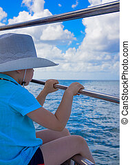 a boy in a hat on a yacht - a little boy in a hat and shirt...