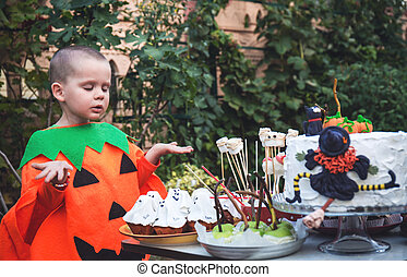 pumpkin suit near a table with treats