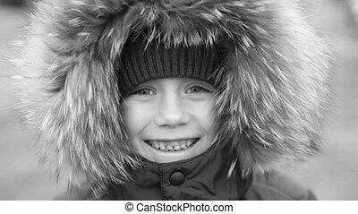 A boy in a warm winter jacket - A child in a warm winter...