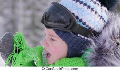A boy in a winter Park, face close-up .Winter frosty ....