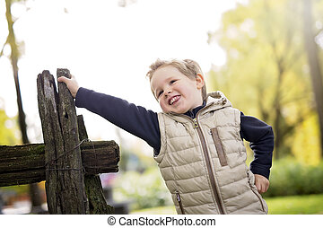 boy in autumn season in a park