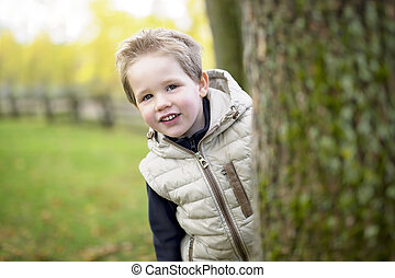 boy in autumn season in a park