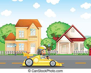 A boy in his racing car across the neighborhood -...