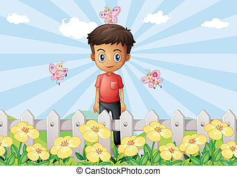 A boy in the garden with a fence
