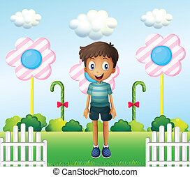A boy in the garden with flower lollipops