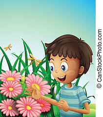 A boy in the garden with flowers and dragonflies