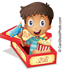 A boy inside the box holding a popcorn and a ticket