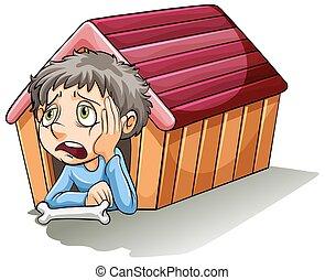 A boy inside the doghouse