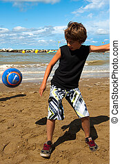 playing football on the beach