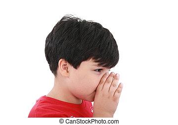 a boy is telling a secret with a hand symbol