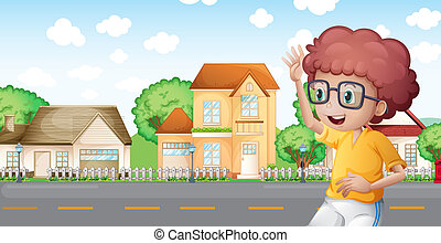 A boy jogging in front of the neighborhood