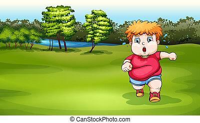 A boy jogging near the river