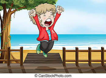 A boy jumping happily in the bridge