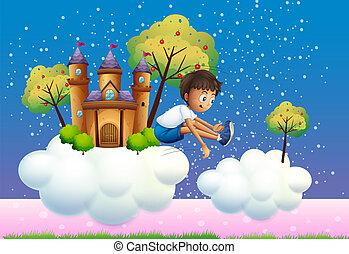 A boy jumping near the castle