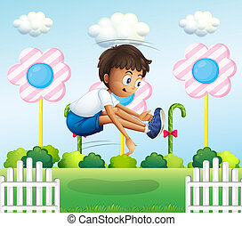 A boy jumping near the fence