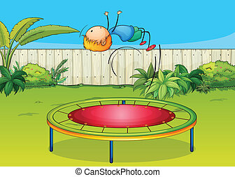 A boy jumping on a trampoline