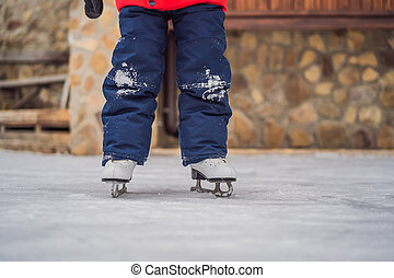 A boy just learning to ice skate