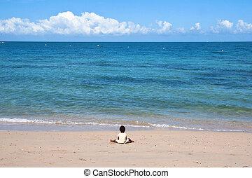 Blue Beach at New Caledonia - a boy playing at Blue Beach at...