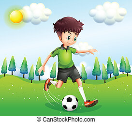 A boy playing football in the hill