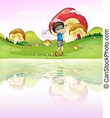 A boy playing golf at the riverbank