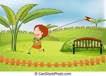 A boy playing kite