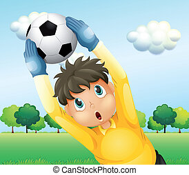 A boy playing soccer with a yellow uniform