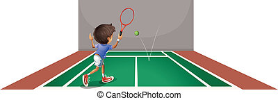 A boy playing tennis at the court