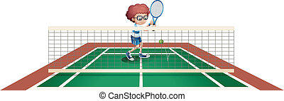 A boy playing tennis at the tennis court