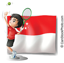 A boy playing tennis in front of the flag of Singapore