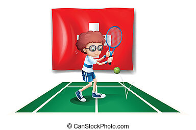 A boy playing tennis in front of the Switzerland flag