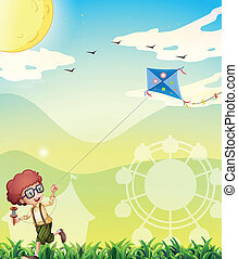A boy playing with his kite