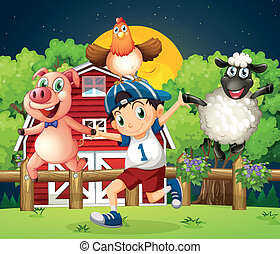 A boy playing with the farm animals