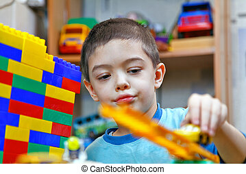 a boy plays in the constructor