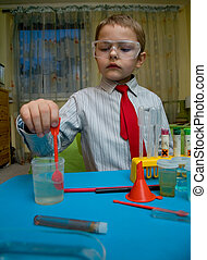 A boy plays in the scientist chemist