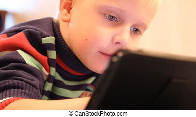 A boy plays in the Tablet PC