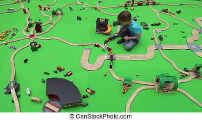 A boy plays on children's educational playground with toy...