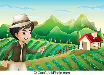 A boy pointing at the barnhouse at the farm