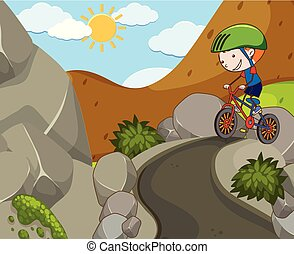 A Boy Riding a Bicycle at Mountain