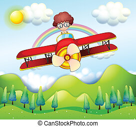 A boy riding in a red plane