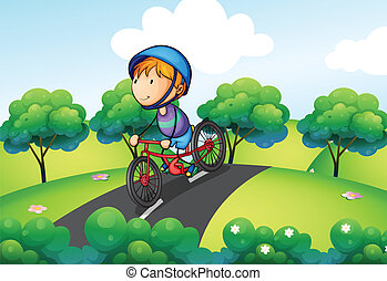 A boy riding in his bike