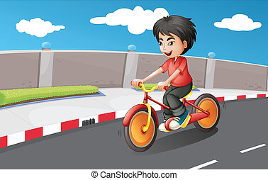 A boy riding in his bike with orange wheels