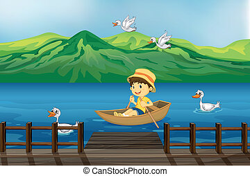 A boy riding on a wooden boat