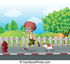 A boy running along the road with his pet