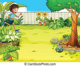 A boy running at the backyard