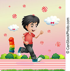 A boy running outside with candy balls